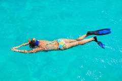 Snorkeler. Young woman snorkeling in a tropical lagoon Stock Images
