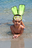 Snorkeler. Smiling happy boy posing on a beach wearing snorkeling equipment Stock Photos