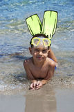 Snorkeler. Smiling happy boy posing on a beach wearing snorkeling equipment Stock Photo