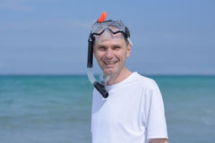 Snorkeler. Man with mask and snorkel against a sea Royalty Free Stock Photos