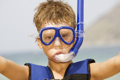 Snorkeler. Portrait of nice kid is getting ready for snorkeling Royalty Free Stock Image
