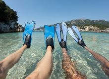Snorkeler couple with blue flippers stock photography