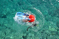 Snorkeler diving in the sea. Snorkeler man diving in the sea Royalty Free Stock Photos