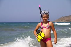 Snorkeler. Girl posing on a beach wearing snorkeling equipment Royalty Free Stock Image