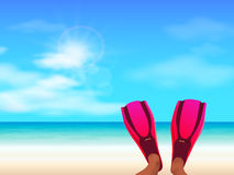 Snorkeler lying on a tropical beach with pink fins. Happy Sunny day. Snorkeler lying on a tropical beach with pink fins Royalty Free Stock Image