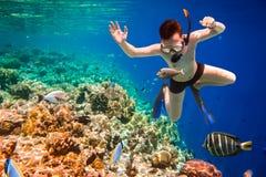 Snorkeler Maldives Indian Ocean coral reef. Stock Photos
