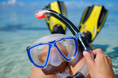 Snorkeler relaxing on the beach Stock Photography