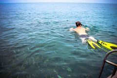 Snorkeler in the sea near boat. Beautiful seascape Stock Photography