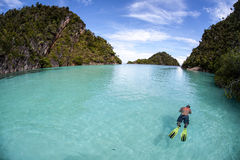 Snorkeler in Shallow Water Between Islands Stock Photos