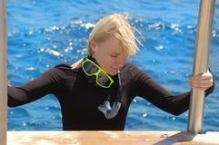 Snorkeler. Tourist woman bathing on a tropical beach Royalty Free Stock Photos