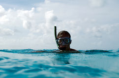 Snorkeler in a turquoise lagoon Stock Photography