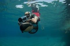 Snorkeler on underwater scooter Stock Photo