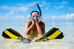 Snorkeler woman having fun on the tropical beach. Royalty Free Stock Image