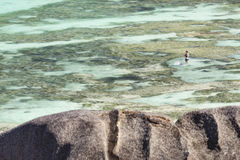 Snorkelers in La Digue, Seychelles, editorial. LA DIGUE - AUGUST 12: Snorkelers in the lagoon of Anse Source D`Argent in La Digue, Seychelles on August 12, 2014 Stock Photography