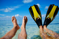 Snorkelers relaxing on the beach.  Royalty Free Stock Photo
