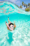 Snorkeling. Beautiful woman snorkeling in clear tropical turquoise waters on summer vacation Royalty Free Stock Photos
