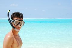 Snorkeling. Closeup of a young snorkeler man in a tropical island Royalty Free Stock Images