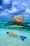 Snorkeling. Woman snorkeling in Indian ocean, Seychelles Royalty Free Stock Images