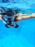 Snorkeling. Woman swimming under water in snorkeling mask for looking marine life Royalty Free Stock Images
