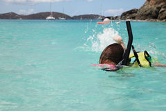 Snorkeling. Young girl swims with snorkeling gear, St. John stock images