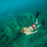 Snorkeling. Young man free diving and snorkeling on a lively reef Stock Photo