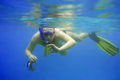 Snorkeling. With camera. Underwater photographer stock image
