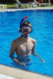 Snorkeling boy. Teenager with mask and snorkel in a swimming-pool Royalty Free Stock Images