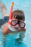 Snorkeling boy. Boy in snorkeling mask with snorkel in pool at aqua park royalty free stock photography