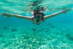 Snorkeling in the Caribbean Sea. Young women at snorkeling in the Caribbean Sea Royalty Free Stock Photo