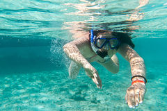 Snorkeling in the Caribbean Sea. Young woman at snorkeling in the Caribbean Sea Stock Images