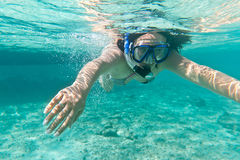 Snorkeling in the Caribbean Sea. Young woman at snorkeling in the Caribbean Sea Royalty Free Stock Photography