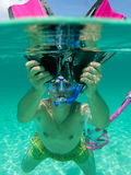 Snorkeling in clear water royalty free stock photos
