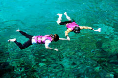 Snorkeling couple. Romantic couple holding hand - snorkeling Royalty Free Stock Photo
