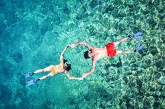 Snorkeling couple, drone shot royalty free stock photos