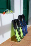 Snorkeling equipment. Canary Islands, Lanzarote. Snorkeling equipment (blue flippers, yellow snorkel and transparent diving mask) placed in the front of the Royalty Free Stock Image