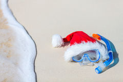 Snorkeling equipment and Santa hat Stock Images