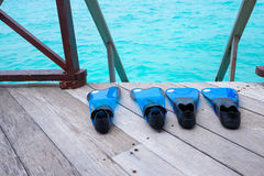 Snorkeling fins on sea deck Stock Photos