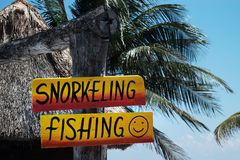 Snorkeling and fishing sign. At tropical beach stock image