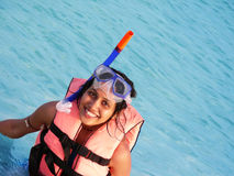 Snorkeling Fun. A young girl having fun while snorkeling in the ocean Stock Photo