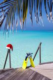 Snorkeling gear and christmas hat on a wooden jetty royalty free stock photos