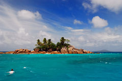 Snorkeling at an isolated island. St. Pierre rocky island near the North coast of Praslin, Seychelles stock image