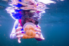 Snorkeling in Jellyfish lake with life jacket. Palau Royalty Free Stock Photography