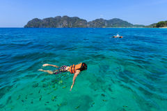 Snorkeling in Krabi's sea. Snorkeling with fishes over coral reef in Krabi's sea ,Thailand Stock Photo