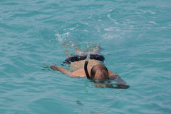 Snorkeling in the lagoon. Closeup of a snorkeler in a lagoon Royalty Free Stock Images