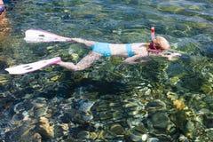 Snorkeling. Little girl snorkeling in Mediterranean Sea Royalty Free Stock Photography