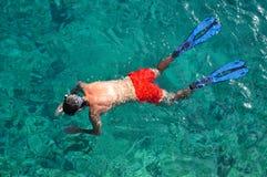 Snorkeling man Stock Images