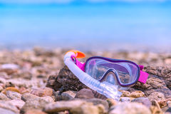 Snorkeling Mask Dry Snorkel Water Sports Gear on Stone Beach Coastline Sea Relax Summer Vacation Holiday Concept Tone. Scuba Diving Snorkeling Mask Dry Snorkel Royalty Free Stock Photos