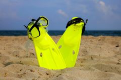Snorkeling mask and fins on the sandy beach stock photo