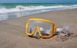Snorkeling mask on sea beach Royalty Free Stock Photos