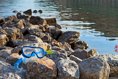 Snorkeling mask at sea. Snorkeling mask on the stones at sea royalty free stock photo